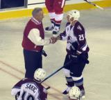 Mickey Redmond and Mike Keane shake hands at the end of the 2016 Stadium Series Alumni Game at Coors Field.