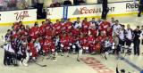 The Detroit Red Wings and Colorado Avalanche alumni teams pose for a group photo after the 2016 Stadium Series Alumni Game at Coors Field.