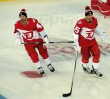 Darren Helm and Riley Sheahan skate in the neutral zone during pre-game warmups prior to the Stadium Series game in Denver.