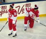 Gustav Nyquist and Jonathan Ericsson stand near the boards during pre-game warmups prior to the Stadium Series game in Denver.