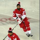 Kyle Quincey skates in the neutral zone during pre-game warmups prior to the Stadium Series game in Denver.