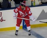 Henrik Zetterberg crouches at the bench during pre-game warmups prior to the Stadium Series game in Denver.