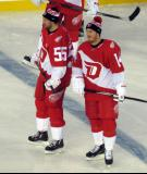 Niklas Kronwall and Gustav Nyquist stand at the blue line during pre-game warmups prior to the Stadium Series game in Denver.