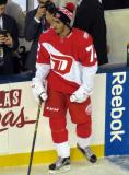 Andreas Athanasiou stands at the bench during pre-game warmups prior to the Stadium Series game in Denver.