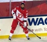 Kyle Quincey stands at the boards during pre-game warmups prior to the Stadium Series game in Denver.