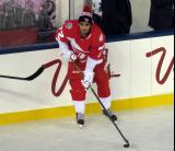 Andreas Athanasiou holds onto the puck at the boards during pre-game warmups prior to the Stadium Series game in Denver.