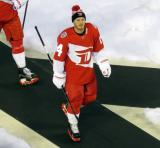 Gustav Nyquist walks to the Red Wings' dugout after pre-game warmups prior to the Stadium Series game in Denver.