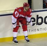 Darren Helm crouches at the boards prior to the start of the Stadium Series game in Denver.