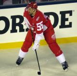 Niklas Kronwall gets set for a faceoff during the Stadium Series game in Denver.