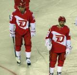 Tomas Jurco and Darren Helm skate off the ice at the end of the second period of the Stadium Series game in Denver.