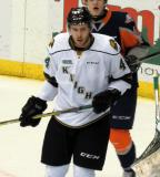 Jacob Graves of the London Knights goes to the front of the net in a game against the Flint Firebirds in Saginaw.