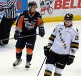 Vili Saarijarvi of the Flint Firebirds and Chad Heffernan of the London Knights skate during a stop in play of a game in Saginaw.