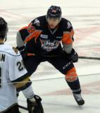 Zach Grzelewski gets set for a faceoff during a Flint Firebirds home game in Saginaw.