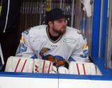 Jake Paterson of the Toledo Walleye sits on the bench during a game against the Kalamazoo Wings.