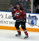 Brett Ponich skates near the boards during a Kalamazoo Wings game.