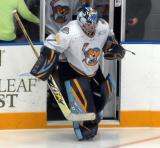 Jeff Lerg of the Toledo Walleye leads his team onto the ice for the second period of a game against the Kalamazoo Wings.