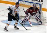 Josh Shalla of the Toledo Walleye sets up in front of Joel Martin's net during a Kalamazoo Wings game.