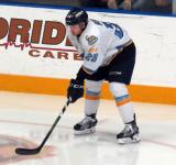 Kyle Bonis of the Toledo Walleye gets set for a faceoff during a game against the Kalamazoo Wings.