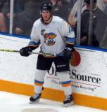 Matt Caito of the Toledo Walleye stands at the boards during a game against the Kalamazoo Wings.