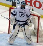 Ben Bishop of the Tampa Bay Lightning gets set in his crease during a playoff game against the Detroit Red Wings.
