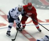Ryan Callahan of the Tampa Bay Lightning and Justin Abdelkader line up next to each other for a faceoff.