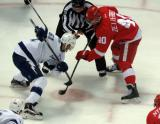 Henrik Zetterberg takes a faceoff against Valtteri Filppula of the Tampa Bay Lightning