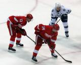 Pavel Datsyuk, Gustav Nyquist, and Tampa Bay's Ryan Callahan get set for a faceoff.