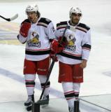 Mitch Callahan and Andreas Athanasiou skate across the blue line during a stop in play in a Grand Rapids Griffins game.
