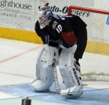 Joonas Korpisalo of the Lake Erie Monsters crouches in his crease during a stop in play in a game against the Grand Rapids Griffins.