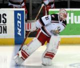 Jared Coreau leads the Grand Rapids Griffins onto the ice for the second period.