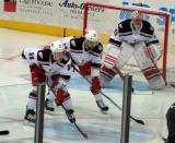 Tyler Bertuzzi and Brian Lashoff line up for a faceoff to the left of goalie Jared Coreau during a Grand Rapids Griffins game.