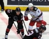 Anthony Mantha lines up next to Sonny Milano of the Lake Erie Monsters on a faceoff in a Grand Rapids Griffins game.