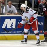 Robbie Russo plays the puck out of the corner during a Grand Rapids Griffins game.