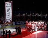 The Red Wings look on as their 2001-02 Stanley Cup Championship banner is unveiled.