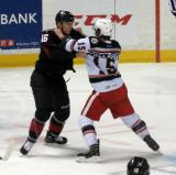 Mitch Callahan and Kerby Rychel of the Lake Erie Monsters fight during a Grand Rapids Griffins game.