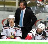 Grand Rapids Griffins head coach Todd Nelson stands at the bench behind players Louis-Marc Aubry and Daniel Cleary.