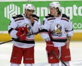 Andreas Athanasiou and Tyler Bertuzzi stand during a stop in play in a Grand Rapids Griffins game.