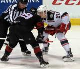 Louis-Marc Aubry lines up for a faceoff against Michael Chaput of the Lake Erie Monsters during a Grand Rapids Griffins game.