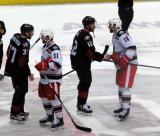 Daniel Cleary and Brian Lashoff of the Grand Rapids Griffins lead the handshake line with Ryan Craig and Markus Hannikainen of the Lake Erie Monsters.