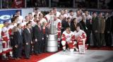Members of the Detroit Red Wings organization pose for a photo with the Stanley Cup during the banner-raising ceremony for their 2002 Stanley Cup Championship.