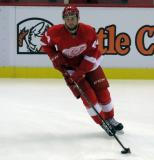 Dylan Sadowy skates in the neutral zone during pre-game warmups before a preseason game.