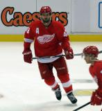 Darren Helm skates in the neutral zone during pre-game warmups before a preseason game.