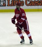 Riley Sheahan skates in the neutral zone during pre-game warmups before a preseason game.