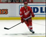 Mike Green skates in the neutral zone during pre-game warmups before a preseason game.