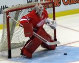 Jimmy Howard moves to face a shot during pre-game warmups before a preseason game.