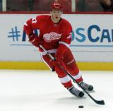 Evgeny Svechnikov skates with the puck during pre-game warmups before a preseason game.