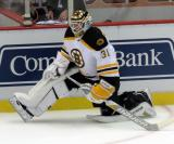 Zane McIntyre of the Boston Bruins stretches near the boards during pre-game warmups before a preseason game against the Detroit Red Wings.