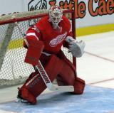 Jimmy Howard knocks aside a shot during pre-game warmups before a preseason game.