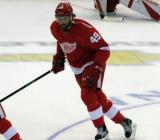 Eric Tangradi skates in the neutral zone during pre-game warmups before a preseason game.