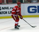 Darren Helm looks to make a pass during pre-game warmups before a preseason game.
